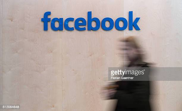 A woman walks in front of the lettering of Facebook on February 24 2016 in Berlin Germany Facebook presented its Innovation Hub where new technology...