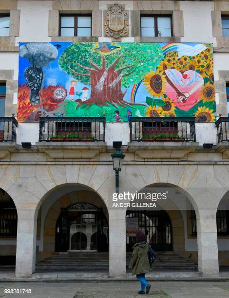 A woman walks in front of the Peace Museum in the Spanish Basque village of Guernica on May 4 2018 In Spain the issue of remembrance is especially...