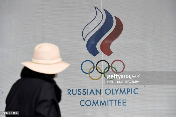 A woman walks in front of the Russian Olympic Committee building in Moscow on December 05 2017 The International Olympic Committee meets from Tuesday...