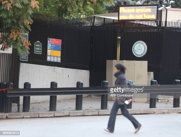 A woman walks in front of the United State Embassy in Ankara on October 9 2017 as United States and Turkey mutually suspended visa services The US...