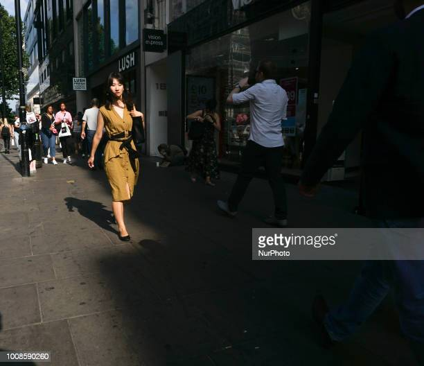 A woman walks in oxford street during a hot day in London July 29 2018 According to the Met Office July is likely to be the hottest month since...