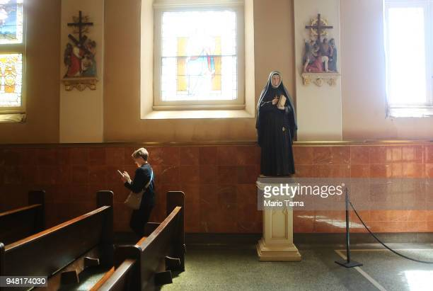 A woman walks in St Mary's Church originally constructed in 1845 as an addition to the Old Ursuline Convent on April 17 2018 in New Orleans Louisiana...