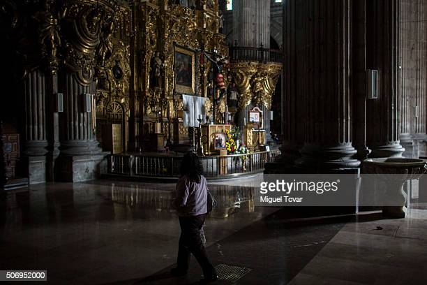 Woman walks inside the Catedral Metropolitana at Plaza de la Constitucion on January 26, 2016 in Mexico City, Mexico. This church will host Pope...