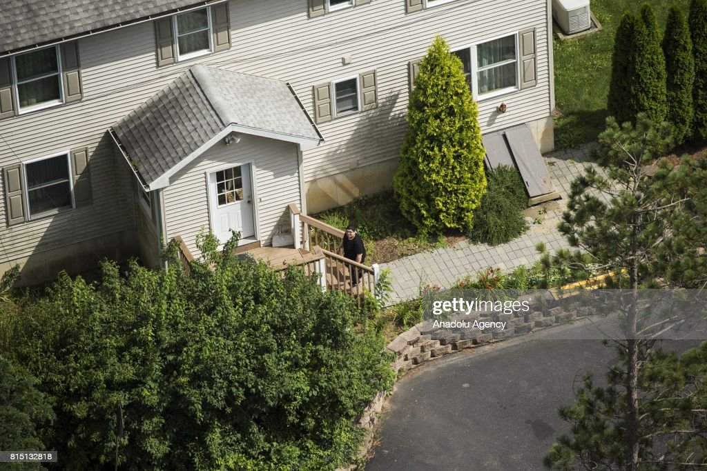 A woman walks into a house at the Fetullah Terrorist Organization (FETO) compound where Fetulah Gulen resides in Saylorsburg, PA., United States on July 15, 2017. 249 people were martyred and nearly 2,200 people injured in the defeated 15th of July 2016 coup attempt, which the Turkish government said was carried out by the Fetullah Terrorist Organization (FETO) led by U.S.-based Turkish citizen Fetullah Gulen. Turkish officials accuse Fetullah Gulen plotting to overthrow the government of President Erdogan as the culmination of a long running campaign to infiltrate Turkish institutions including the military, the police and the judiciary.