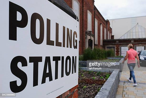 A woman walks into a polling station in a Youth Community Centre as voters head to the polls to cast their vote on the EU Referendum on June 23 2016...