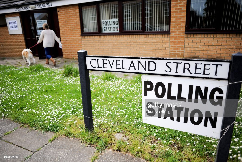 A woman walks into a polling station in Liverton on May 22, 2014 in East Cleveland, England. Millions of voters are going to the polls today in local and European elections.