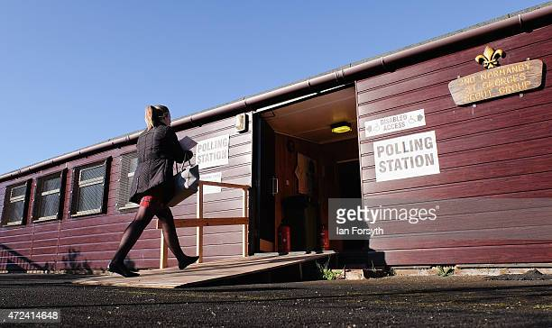 A woman walks into a polling station situated in a scout hut on May 7 2015 in Eston England The nation goes to the polls today to vote on what is...