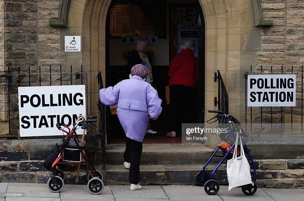 A woman walks into a polling station situated in Saltburn Methodist Church on May 7, 2015 in Saltburn, England. The United Kingdom has gone to the polls to vote for a new government in one of the most closely fought General Elections in recent history. With the result too close to call it is anticipated that there will be no overall clear majority winner and a coalition government will have to be formed once again.
