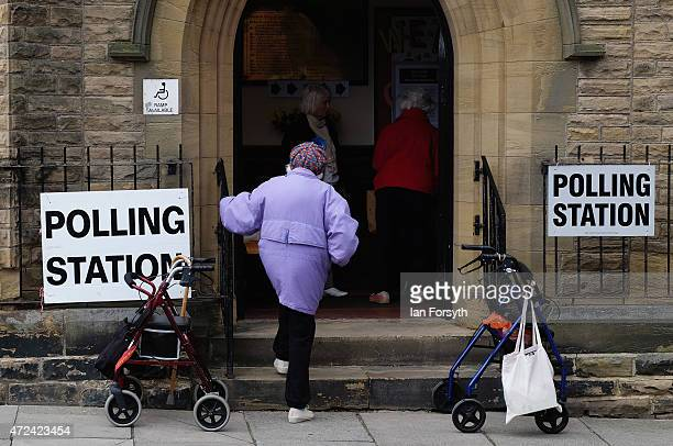 Woman walks into a polling station situated in Saltburn Methodist Church on May 7, 2015 in Saltburn, England. The United Kingdom has gone to the...
