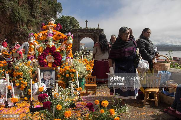 A woman walks near an altar in the cemetery of Janitzio on November 1 2015