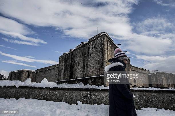 Woman walks near Forte Spagnolo hit by snow in L'Aquila, Italy, on January 19, 2017. A great deal of snow has fallen in the area, which was hit by...