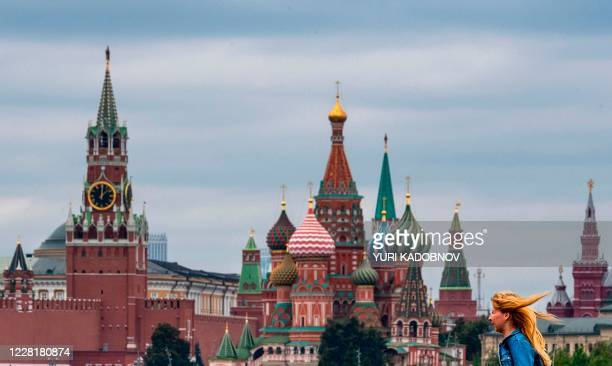 Woman walks near the Kremlin in central Moscow on August 24, 2020.
