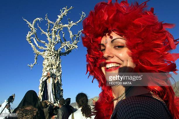 A woman walks near the 'Tree of Time' a sculpture by San Franciscobased artists Dana and Flash at Black Rock City's Burning Man festival in Nevada 04...