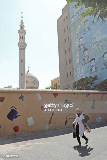 A woman walks near Vali Asr Square in the Iranian capital Tehran on September 7 2019 Iran said Saturday it has fired up advanced centrifuges to boost...
