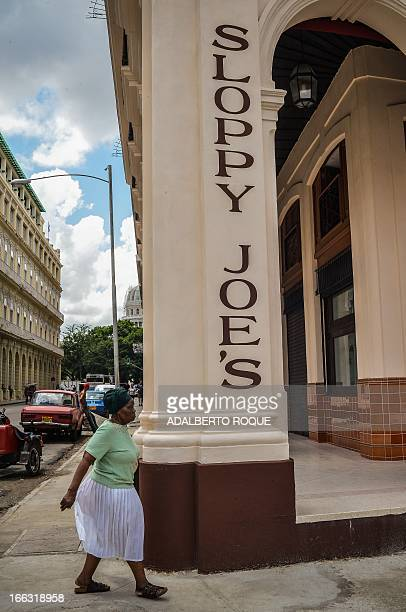 A woman walks next to the newly renovated Sloppy Joe's bar in Havana on April 11 2013 Sloppy was one of the most famous places in the...