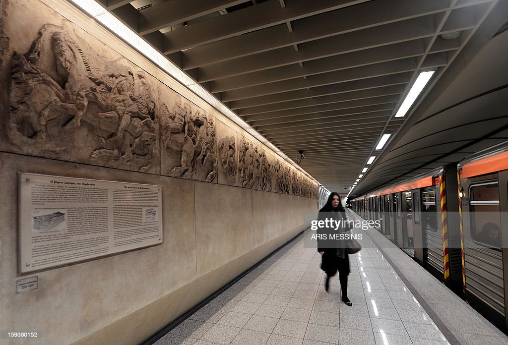 A woman walks on a platform of the Athens' Acropolis metro station on January 11, 2013.