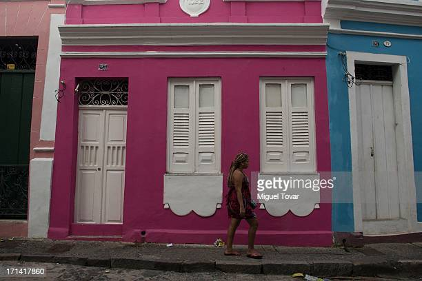 A woman walks on a street of Salvador host city of FIFA Confederations Cup Brazil 2013 on June 23 2013 in Salvador Brazil