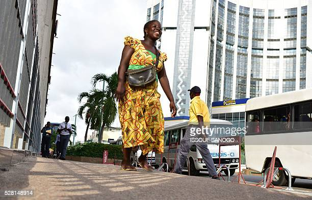 A woman walks on May 3 2016 in the Plateau business district of Abidjan in Ivory Coast / AFP / ISSOUF SANOGO