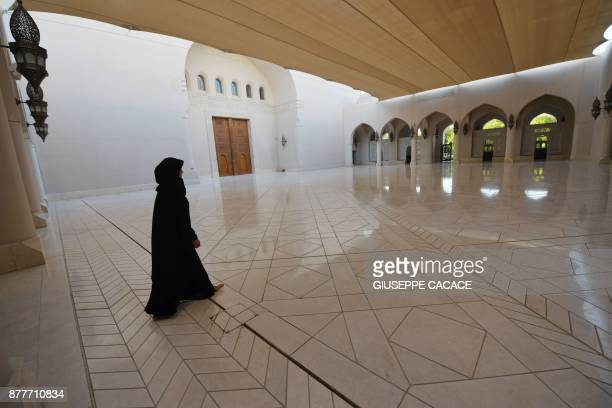 A woman walks on October 31 2017 into Muscat's Sayyida Mazoon mosque in the Gulf sultanate of Oman Oman home to Sunnis Shiites and adherents of the...