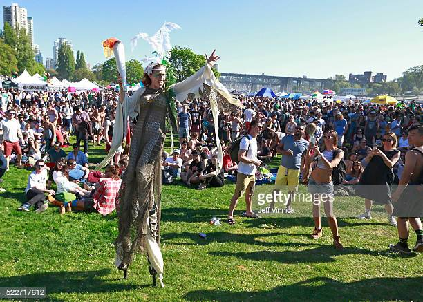A woman walks on stilts through a large crowd as thousands of people gather at 4/20 celebrations on April 20 2016 at Sunset Beach in Vancouver Canada...