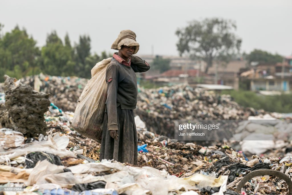 A woman walks on the Dandora rubbish Dump on March 14, 2018 in Nairobi, Kenya. The Dandora landfield is located 8 Kilometer east of the city center of Nairobi, the capital of Kenya. Every day, more than 2.000 metric tonnes of waste are dumped on this site. More than 3000 pickers work day by day at the sprawling 30-acre rubbish dump.