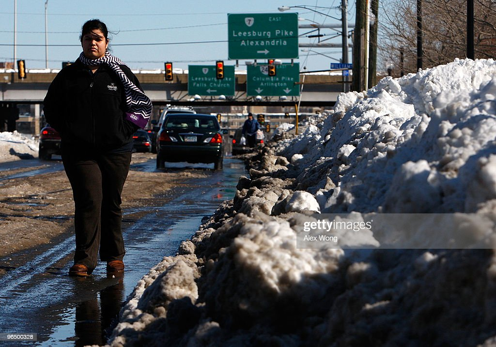 A woman walks on the street next to the traffic because a snow clogged sidewalk February 8, 2010 in Baileys Crossroads, Virginia. The Washington area was hit by one of the biggest snowstorms in the history.
