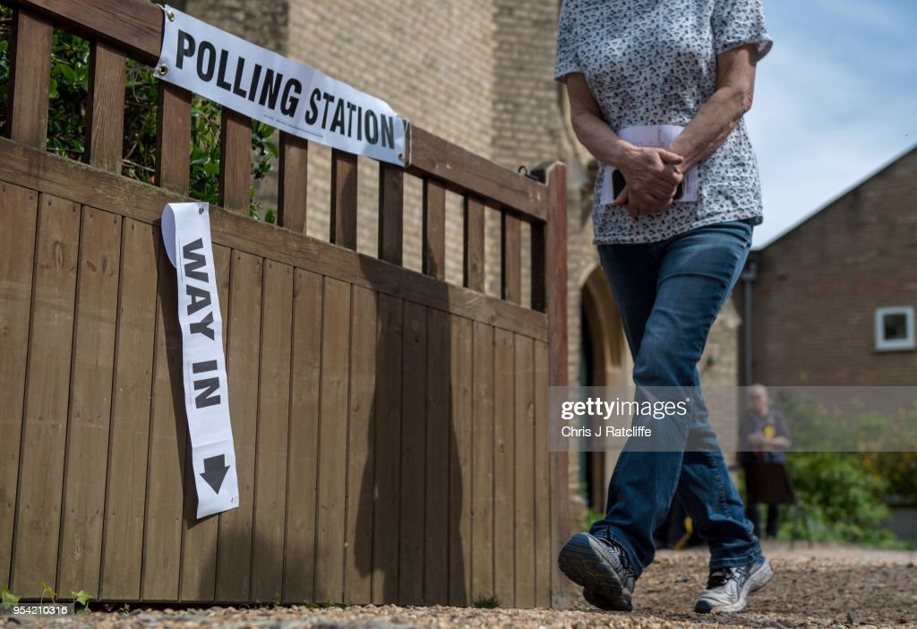 A woman walks out of a polling station in a church in Twickenham as voters go to the polls in the English local council elections on May 3, 2018 in London, England. Votes are being cast in more than 4,300 council areas in the biggest test for the political parties since the general election last year.