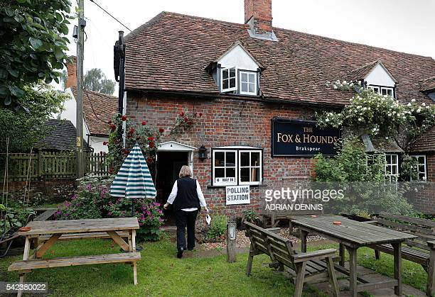 A woman walks out of a temporary polling station in The Fox Hounds public house in Christmas Common near Watlington in the Chilterns southeast of...