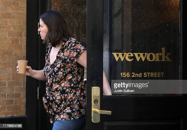 Woman walks out of a WeWork office on October 07, 2019 in San Francisco, California. Days after withdrawing its registration for an initial public...