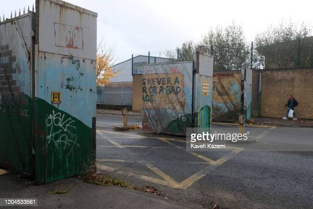 A woman walks out of the Cupar Way which divides the Protestant and Catholic communities on October 30 2019 in Belfast United Kingdom