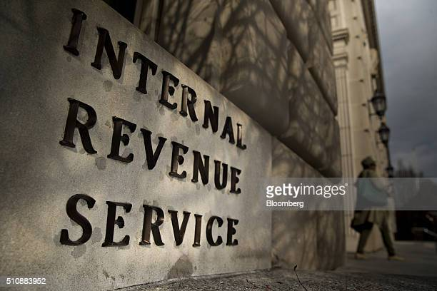 A woman walks out of the Internal Revenue Service headquarters building in Washington DC US on Wednesday Feb 17 2016 Taxpayers have until Monday...