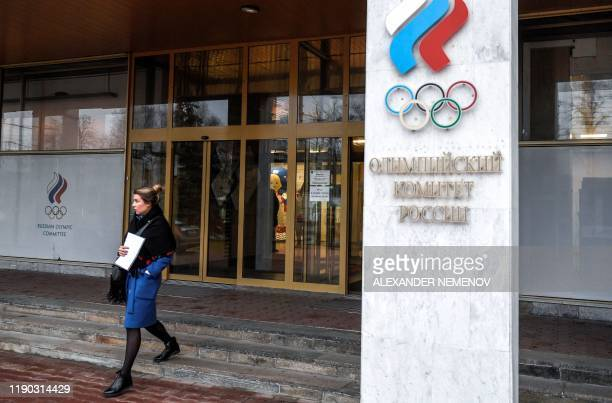 Woman walks out of the Russian Olympic Committee headquarters in Moscow on December 24, 2019 following meetings with the Russian anti-doping agency...