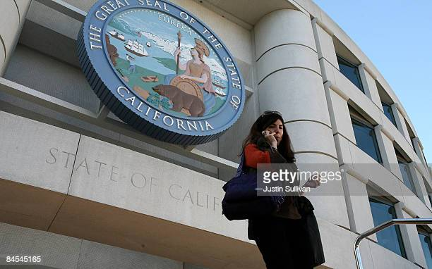 A woman walks out of the State of California building January 29 2009 in San Francisco California California Governor Arnold Schwarzenegger will move...