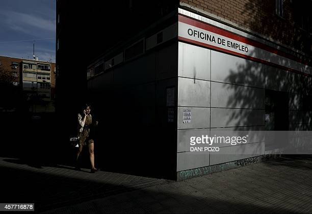 A woman walks outside a government job centre in Madrid October 23 2014 The unemployment rate continued its decline in Spain in the third quarter...