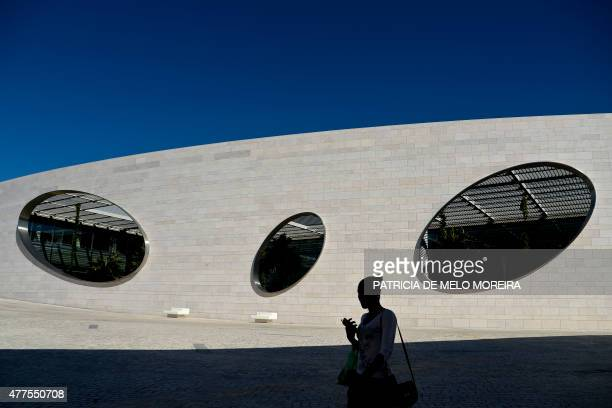 A woman walks outside the Champalimaud Center of the Unknown in Belem a cancer research facility on June 18 2015 in Belem Lisbon Based in Lisbon The...