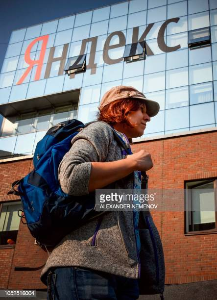 A woman walks outside the headquarters of Yandex company Russia's internet search engine in Moscow on October 19 2018 The Russian internet giant...