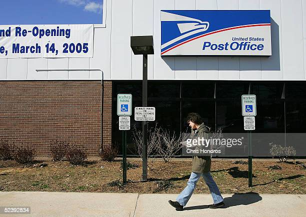 A woman walks outside the Trenton Post Office on its first day open in threeandahalf years March 14 2005 in Hamilton New Jersey The post office was...