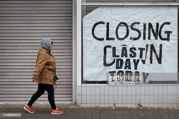 Woman walks passed a closed-down shop on June 10, 2020 in Aberdare, United Kingdom. The Welsh government has further relaxed COVID-19 lockdown...