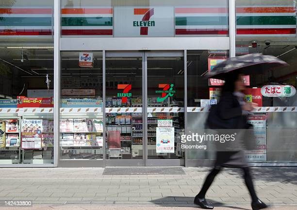 A woman walks past a 7Eleven conveniencestore in Tokyo Japan on Thursday April 5 2012 Seven I Holdings Co owner of the 7Eleven conveniencestore brand...