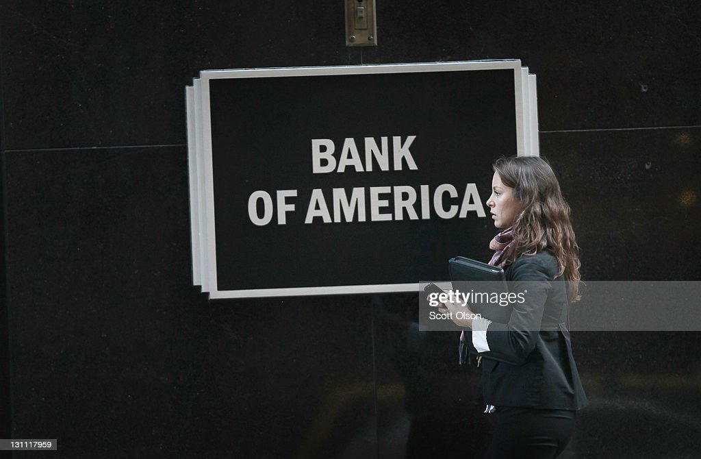 A woman walks past a Bank of America branch in the Financial District on November 1, 2011 in Chicago, Illinois. Bank of America Corp. has reportedly announced they will drop its plan to charge customers a $5-per-month fee for making purchases with their debit cards.