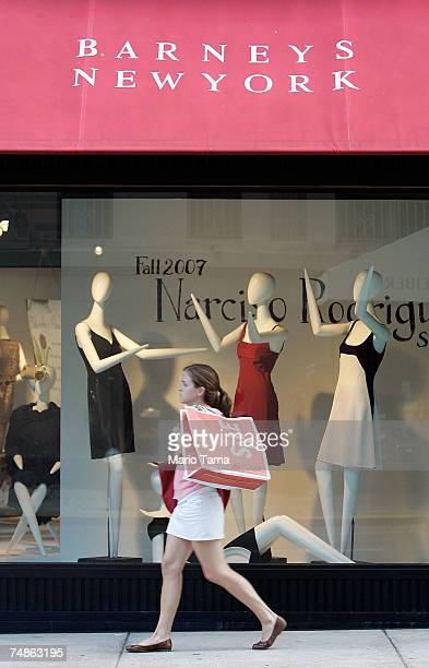 A woman walks past a Barneys New York store June 22 2007 in New York City Jones Apparel Group Inc plans to sell Barneys New York to the Dubai...
