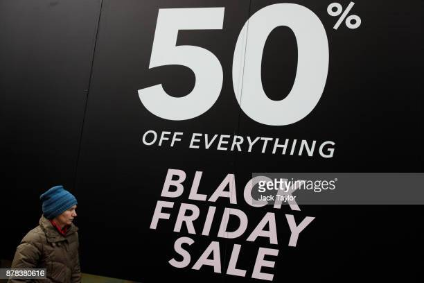 A woman walks past a Black Friday sale sign on Oxford Street on November 24 2017 in London England British retailers offer deals on their products as...
