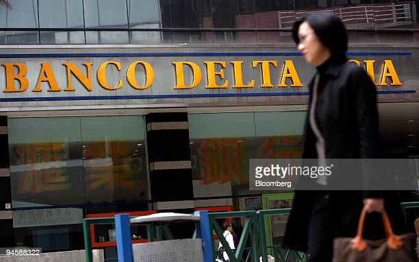 A woman walks past a branch of Banco Delta Asia SARL in Macau China on Wednesday March 14 2007 Macau authorities released $25 million in frozen North...