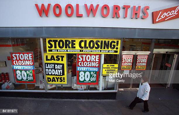 A woman walks past a branch of Woolworths trading for the final time on January 6in Wells England The closure of the high street store which has been...