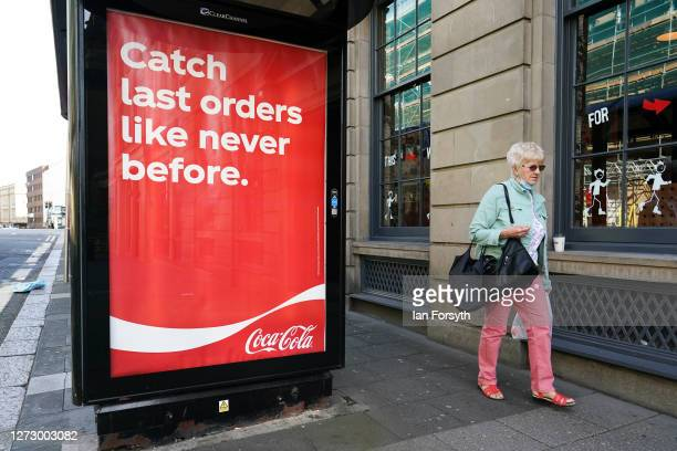A woman walks past a bus stop in Newcastle on September 17 2020 in Newcastle upon Tyne England Almost two million people in northeast England will be...