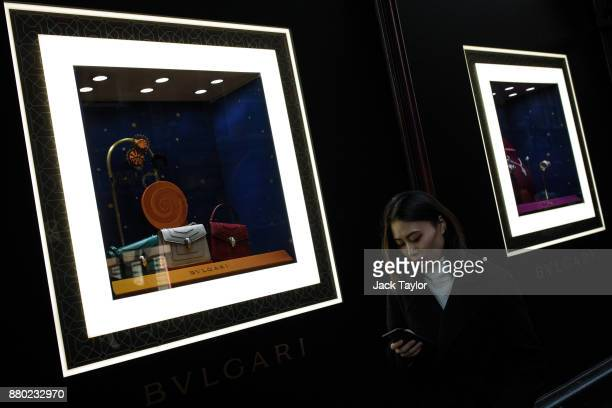 A woman walks past a Bvlgari window display in the Harrods department store on November 24 2017 in London England The American actress Meghan Markle...
