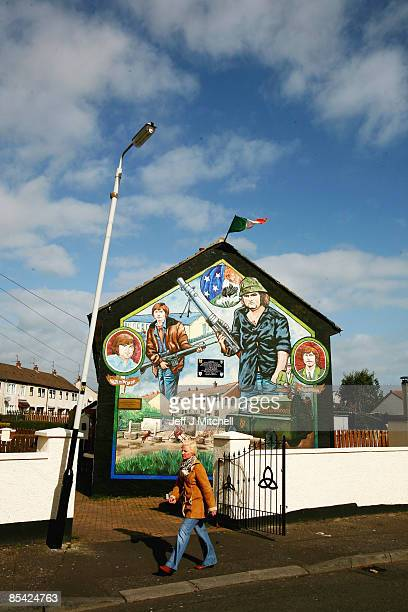 A woman walks past a catholic republican mural in the Ballymurphy estate in Belfast on March 14 2009 in Northern Ireland Communities in Northern...