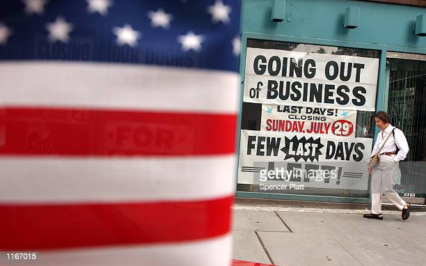 A woman walks past a closed store September 24 2001 in New York City While the economy in New York and the rest of the nation had been showing signs...