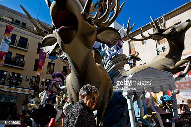 A woman walks past a Falla on March 19 2013 in Valencia Spain The Fallas festival which runs from March 15 until March 19 celebrates the arrival of...
