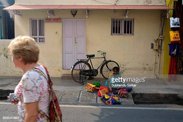 A woman walks past a French colonial building in Puducherry Puducherry formerly known as Pondicherry is a Union Territory of India In 1674...